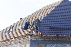 a contractor working on a roofing project