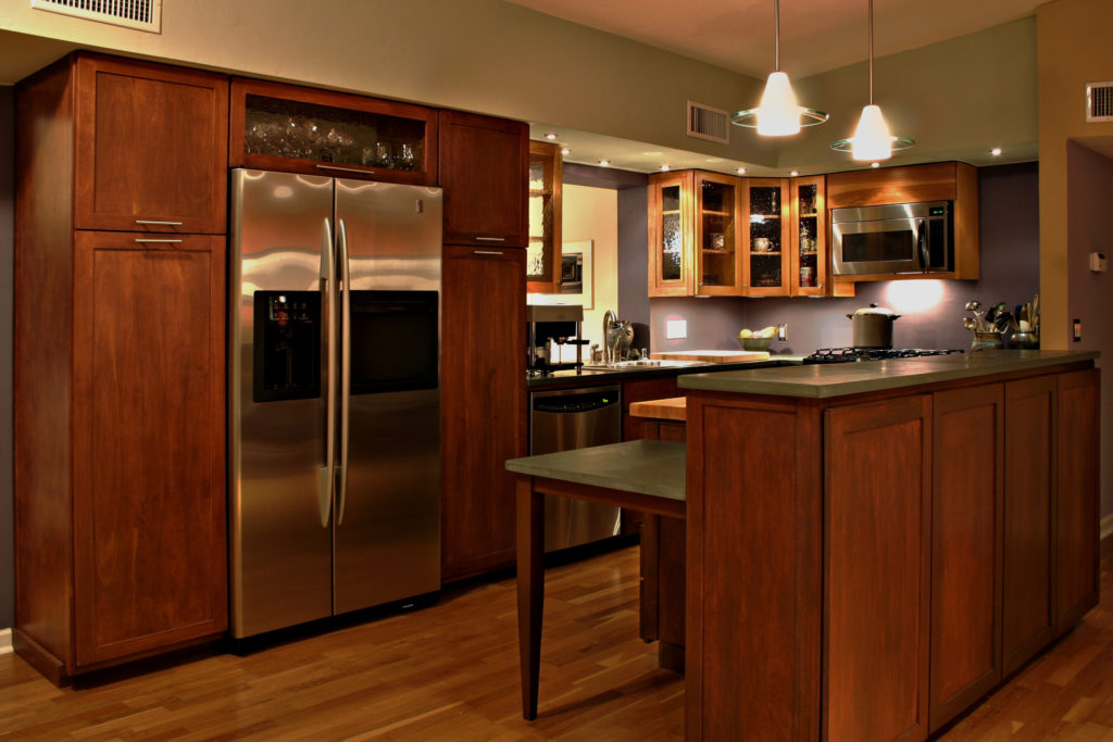 a beautifully modern kitchen with stainless steel appliances